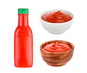 Ketchup in bowl and bottle isolated on white background. Portion of tomato sauce. With clipping path.