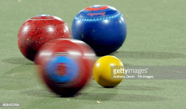 A bowl hits the jack during the lawn bowls women's triple bronze medal final during Day Seven of the 2010 Commonwealth Games at the Jawaharlal Sports...