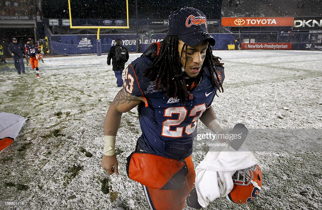 Bowl MVP Prince-Tyson Gulley #23 of the Syracuse Orange runs off the field after a win over the West Virginia Mountaineers in the New Era Pinstripe Bowl at Yankee Stadium on December 29, 2012 in the Bronx borough of New York City.