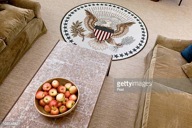 A bowl of apples sitson a table in the newly redecorated Oval Office of the White House August 31 2010 in Washington DC US President Barack Obama...