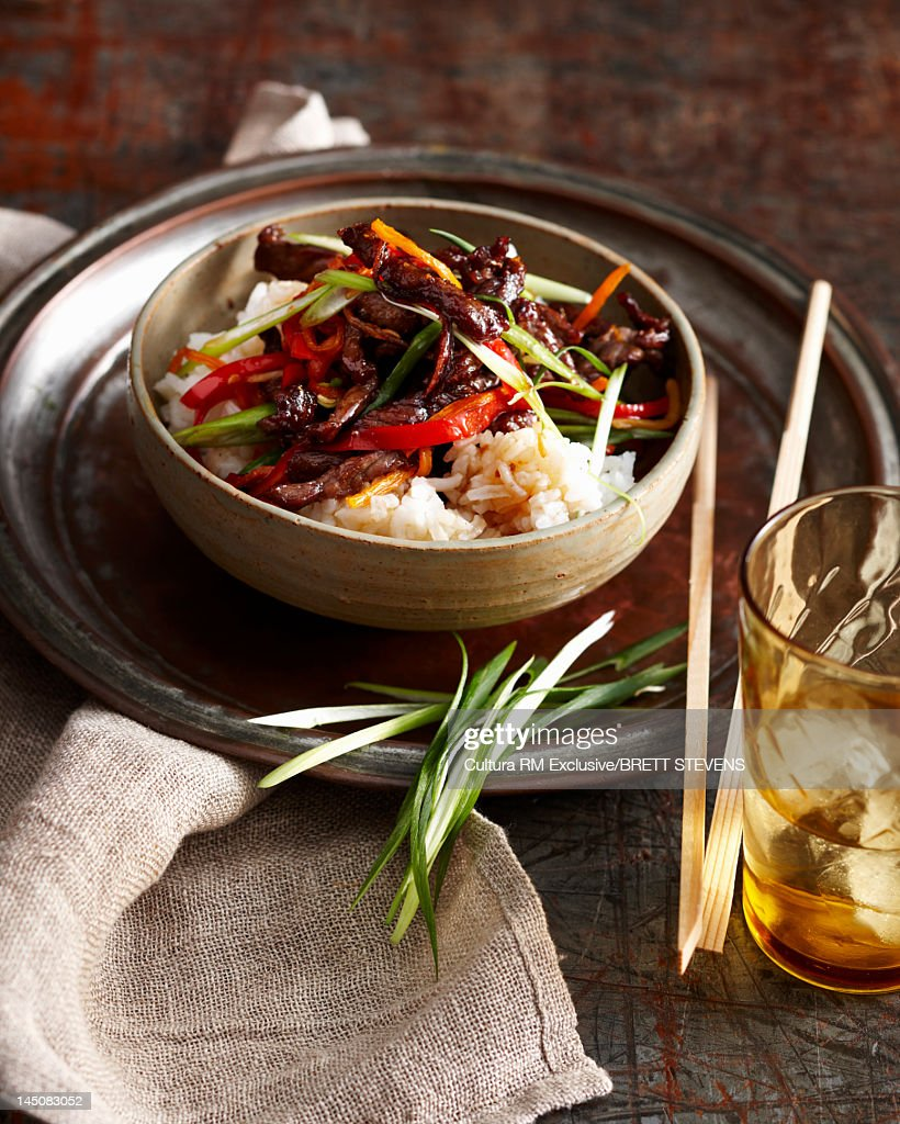 Bowl of beef and vegetables with rice : Stock Photo