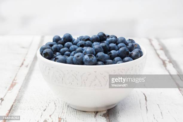 Bowl of blueberries on wood