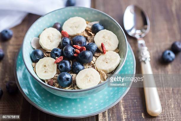 Bowl of blueberry muesli with wolfberries and banana slices