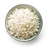 bowl of boiled round rice isolated on white background, top view
