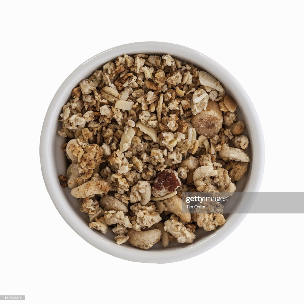 A Bowl Of Breakfast Cereal Clusters On White Stock Photo