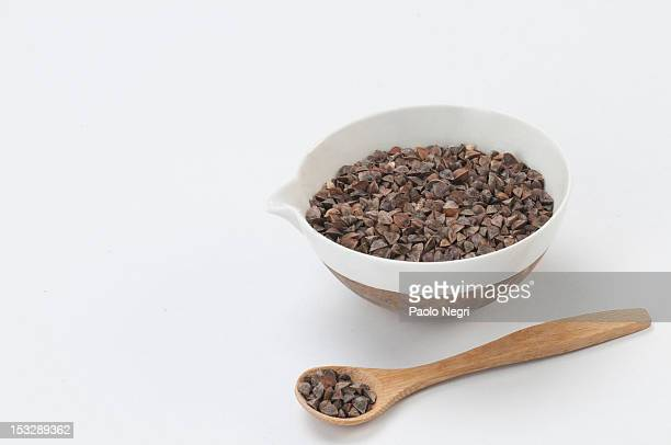 Bowl of buckwheat and a wooden spoon