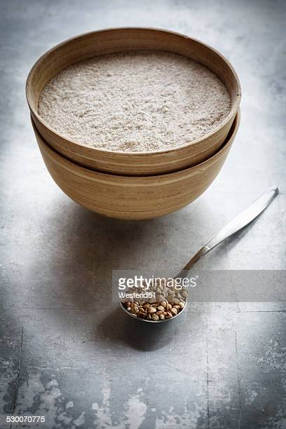 Bowl of buckwheat flour and a spoon of buckwheat grains