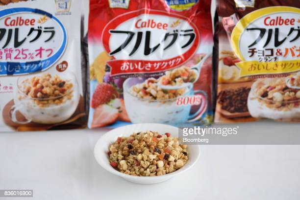 A bowl of Calbee Inc Frugra branded cereal is arranged for a photograph in Tokyo Japan on Tuesday July 18 2017 Calbee's granola snack had been around...