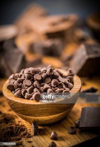 Bowl of chocolate chips on cutting board