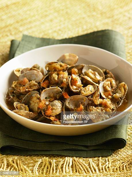 Bowl of clams with tomatoes, close-up