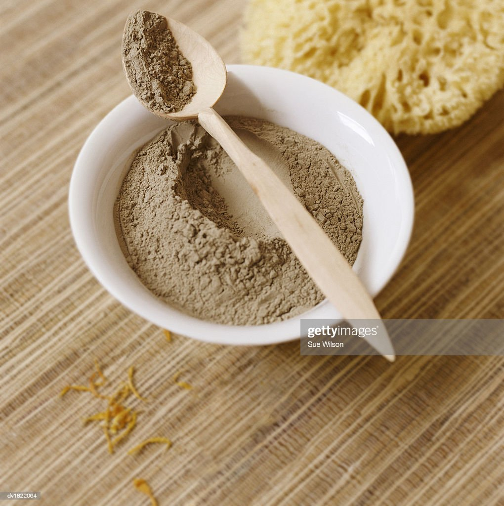 Bowl of Clay, Wooden Spoon and Sponge : Stock Photo