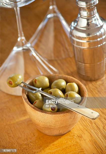 Bowl of cocktail olives with old fork