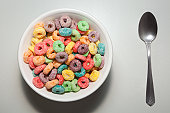 Bowl of colorful breakfast cereal with spoon