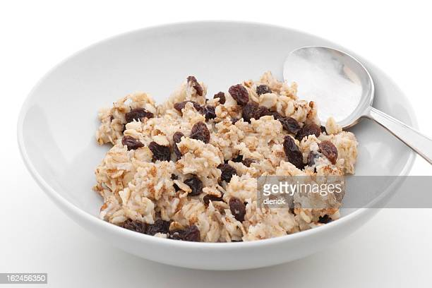 bowl of cooked oatmeal with raisins