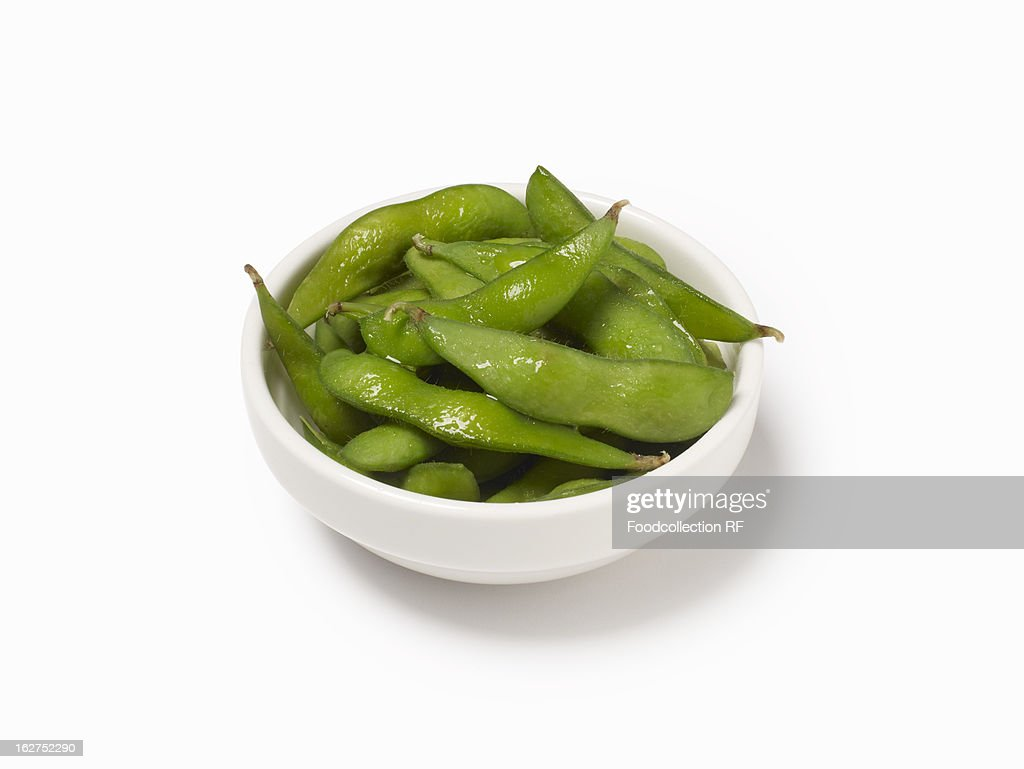 Bowl of cooked soya bean pods : Stock Photo