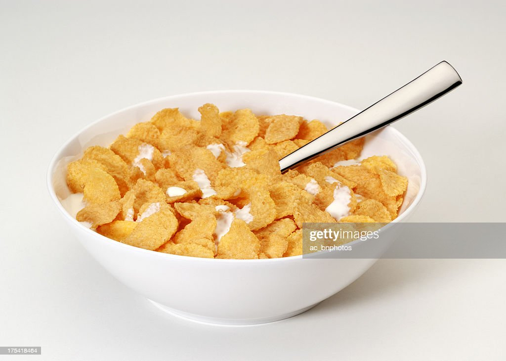 Bowl of corn flakes with spoon : Stock Photo