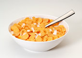 Bowl of corn flakes with spoon