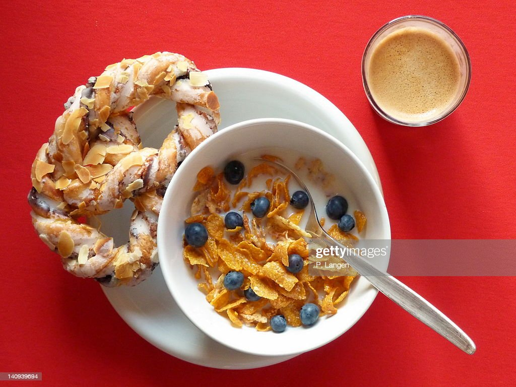 Bowl of cornflakes, milk, blueberry and pretzel : Stock Photo
