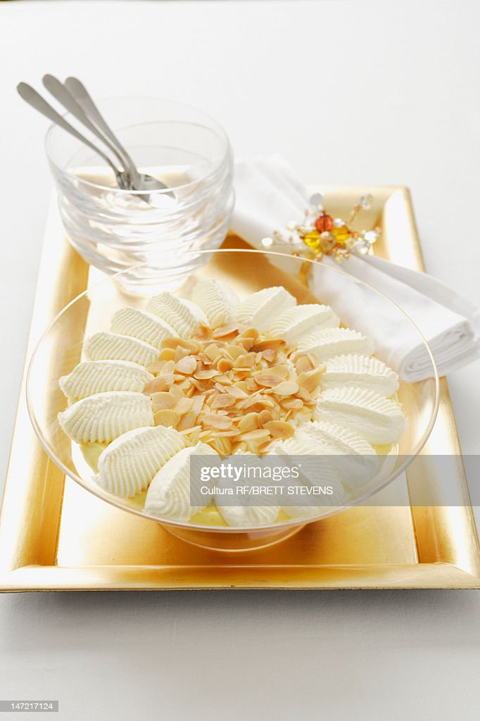 Bowl of custard with nuts and cream : Stock Photo