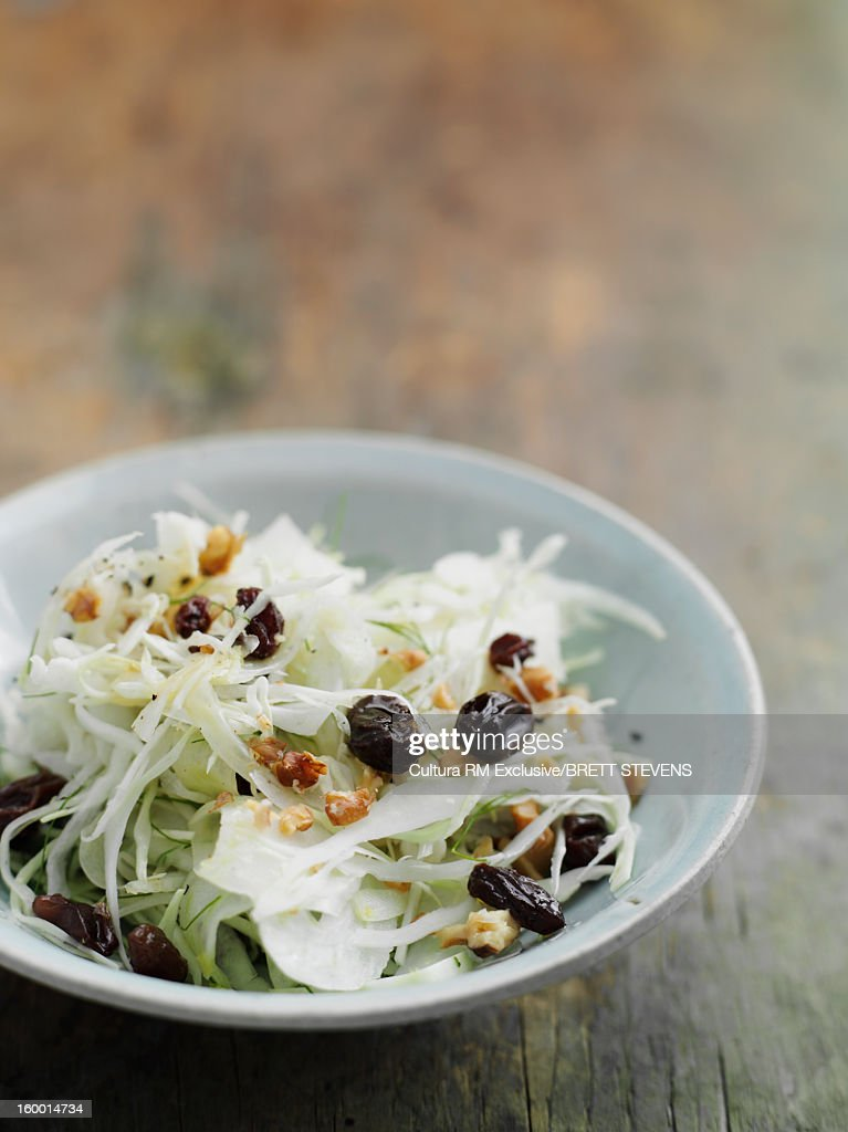 Bowl of fennel and raisin salad : Stock Photo