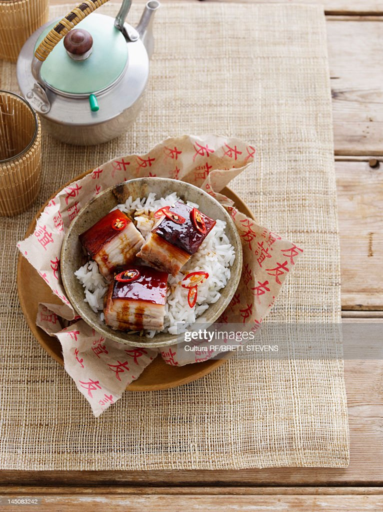 Bowl of fish, vegetables and rice : Stock Photo
