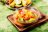 Fresh fruit salad on gray stone table.Colorful fruit salad