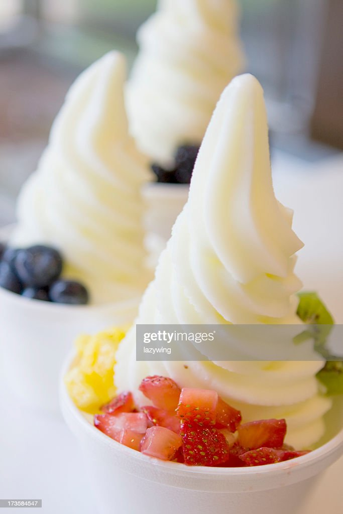 A bowl of fresh fruit with ice cream