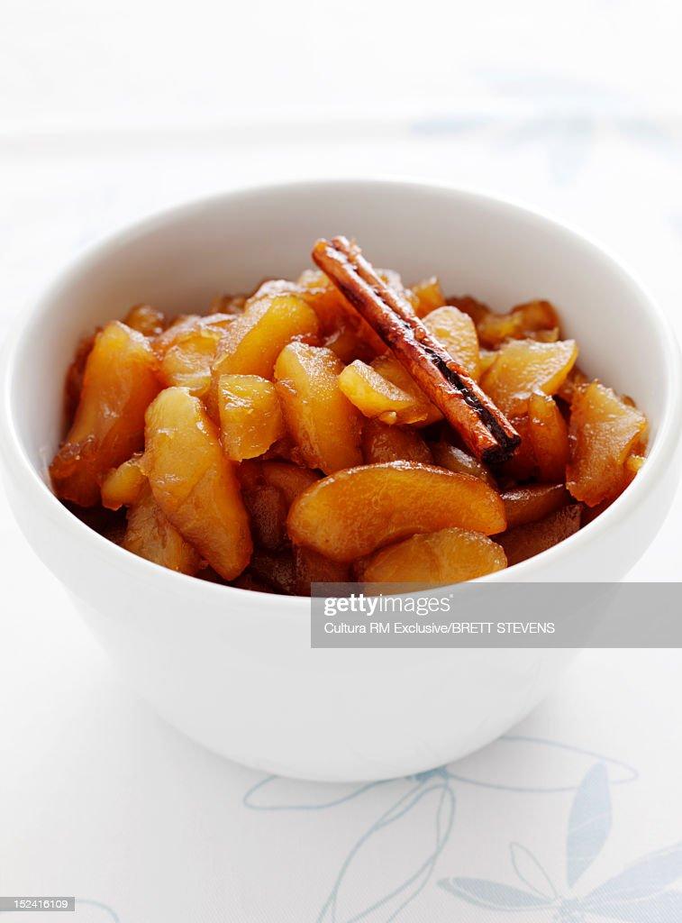 Bowl of fruit and cinnamon : Stock Photo