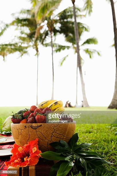 Bowl of fruit and palm trees