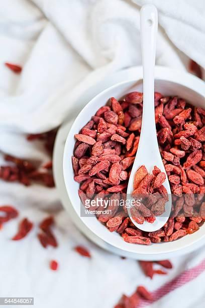Bowl of Goji berries, Lycium barbarum, on cloth