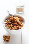 Bowl of granola with oak flakes and roasted pumpkin seeds
