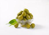 bowl of green olives on white background
