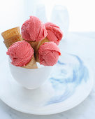 Bowl of ice cream cones filled with strawberry ice cream