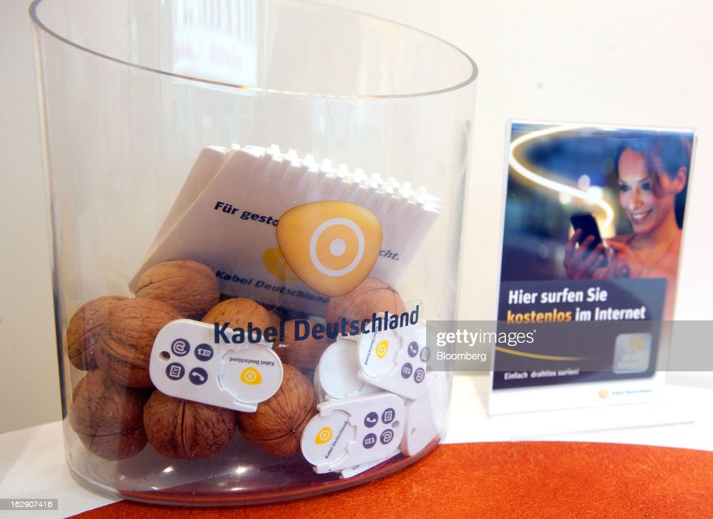 A bowl of Kabel Deutschland-branded promotional gifts are seen inside a store, operated by Kabel Deutschland Holding AG, the German cable operator in Berlin, Germany, on Friday, March 1, 2013. Vodafone Group Plc has put on hold plans to approach Kabel Deutschland Holding AG about a takeover bid after leaks of a potential offer complicated internal discussions, according to three people familiar with the matter. Photographer: Krisztian Bocsi/Bloomberg via Getty Images