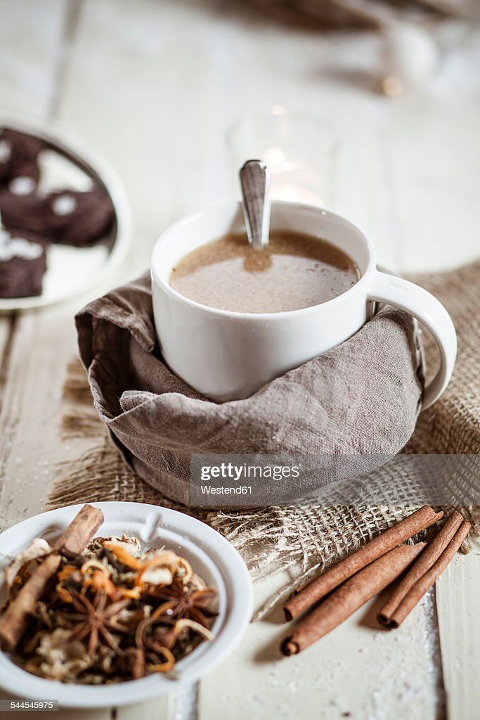 Bowl of Masala chai with almond milk on jute and wood : Stock Photo