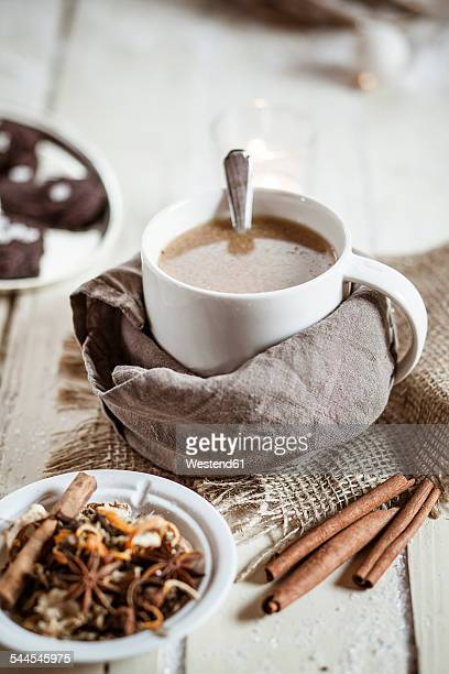 Bowl of Masala chai with almond milk on jute and wood
