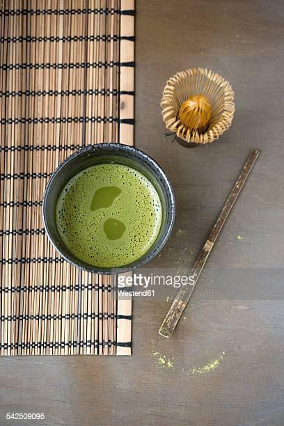 Bowl of Matcha, Matcha whisk, spatula and bamboo place mat