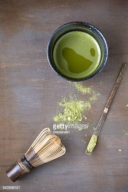 Bowl of Matcha, Matcha whisk, spatula and Matcha tea