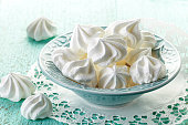 meringue cookies in blue bowl
