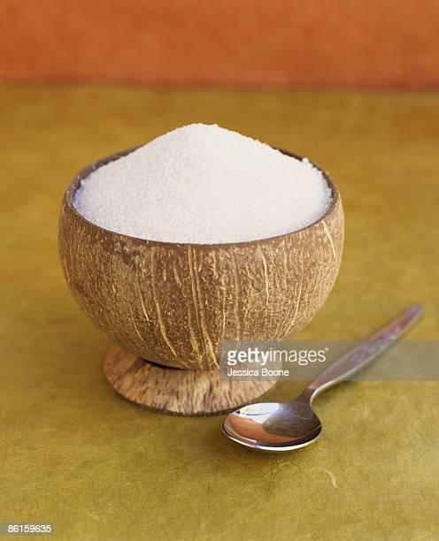 Bowl of milled golden cane sugar