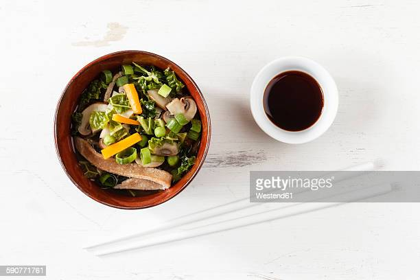 Bowl of miso soup with carrots, champignons and savoy