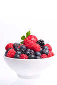 Bowl of mixed berries over clear background