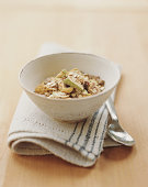 Bowl of muesli on napkin by spoon