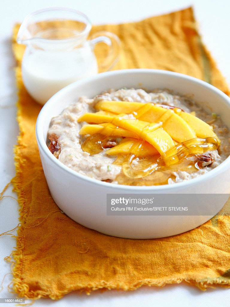 Bowl of muesli with mango : Stock Photo