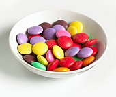 Bowl of multi coloured sweets