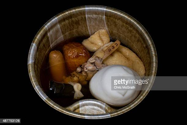 A bowl of oden containing sausage skewed meat fish balls seaweed roll beancurd pocket from a convenience store or 'konbini' is pictured on September...
