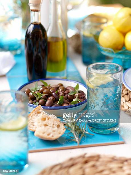 Bowl of olives with bread and herbs