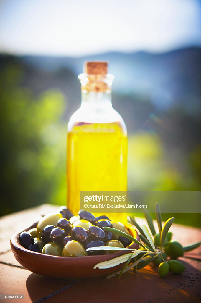 Bowl of olives with olive oil : Stock Photo
