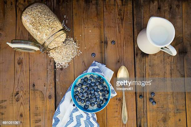 Bowl of overnight oats with blueberries on wood