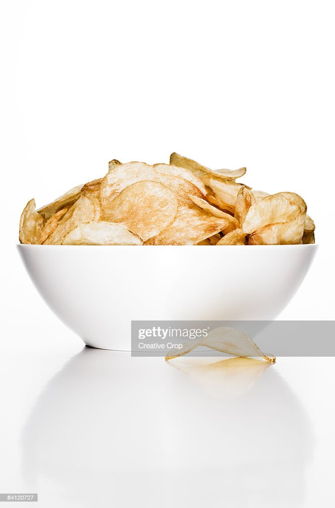 A bowl of potato chips / crisps